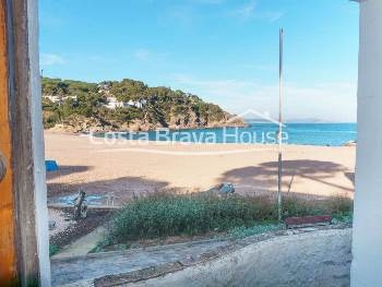 Unique house for sale in the beach front in Sa Riera cove in Begur, located in an enviable position just a few steps from the sea